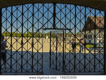 Dachau Concentration Camp Germany - August 29 2015: Arbeit Macht Frei the gate of entrance in extermination camp. Dachau concentration camp was the first of the Nazi concentration camps opened in Germany intended to hold political prisoners.