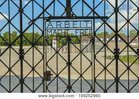 Dachau Concentration Camp Germany - July 30 2016: Arbeit Macht Frei the gate of entrance in extermination camp. Dachau concentration camp was the first of the Nazi concentration camps opened in Germany intended to hold political prisoners.