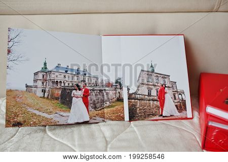 Pages Of Elegant Red Wedding Photobook Or Photoalbum On The Soft Beige Background.