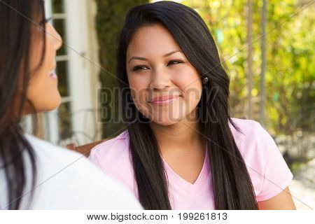 Young teenage girl talking with an adult.