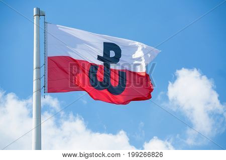 Polish flag with the symbol of Polish Fighting. Symbol of the Warsaw Uprising in 1944