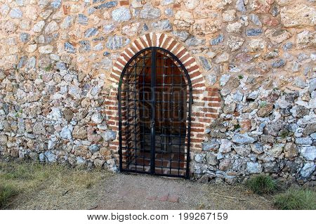 Forged lattice in the archway of Alanya Castle (Alanya, Turkey).