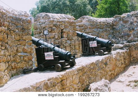 Medieval cannons and the fortress wall of Alanya Castle (Alanya, Turkey).