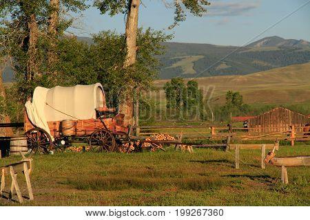 Old western chuck food wagon on farming ranch.
