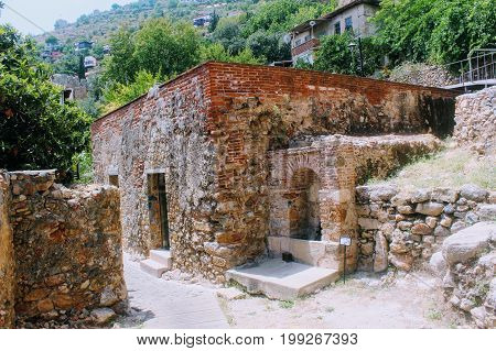 An old stone building on the way to the old shipyard in the Old Town (Alanya, Turkey).