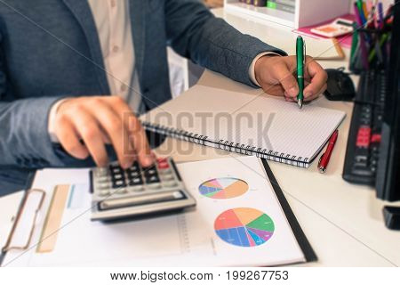 Close up view of bookkeeper or financial inspector hands making report calculating or checking balance. Home finances investment economy saving money or insurance concept - color / Old Polaroid