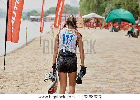 Wet Female Wakeboarder