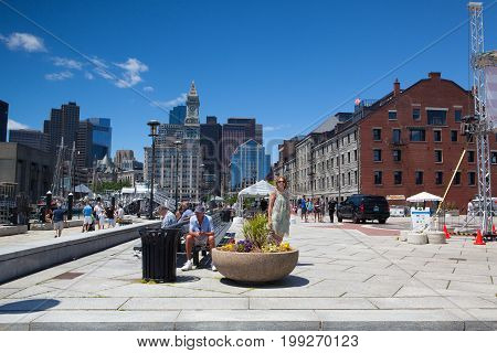 Boston Massachussetts USA - July 2 2016: Architecture in Boston harbor. It is a natural harbor and estuary of Massachusetts Bay. Boston tourism annually brings about 8 billion dollars
