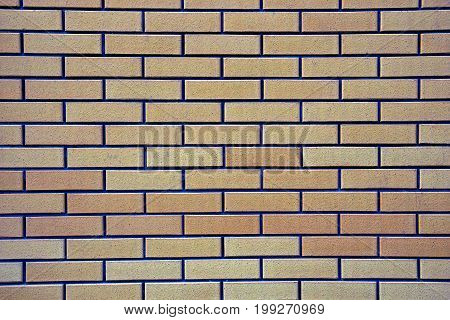 Brown gray grated background of bricks a fragment of the wall of the house
