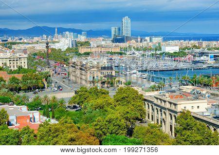Aerial view of Barcelona. Passeig de Colom avenue and Columbus monument La Barceloneta and Port Vell. Catalonia Spain.