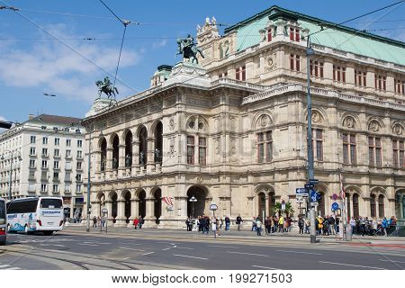VIENNA, AUSTRIA - APR 29th, 2017:Moving traffic in front of the famous and historic State Opera House - Staatsoper in Wien.