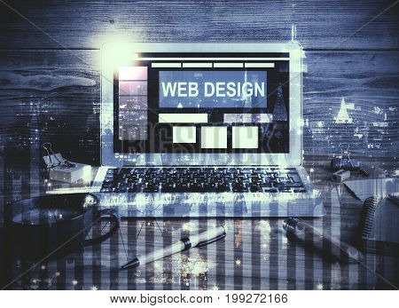 Workplace with web design banner on laptop screen coffee cup supplies and other items on abstract night city background. Internet concept. Double exposure