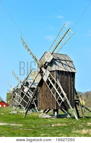 Old wooden windmills on the island Oeland Sweden. poster