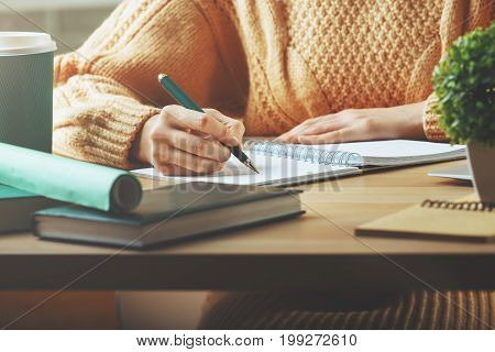 Lady Writing In Notepad