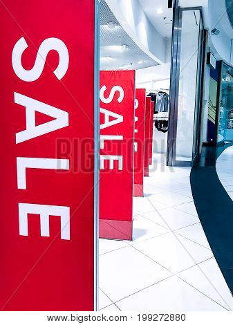 Sale shopping season, promotion discount brand label in front of shop door glasses