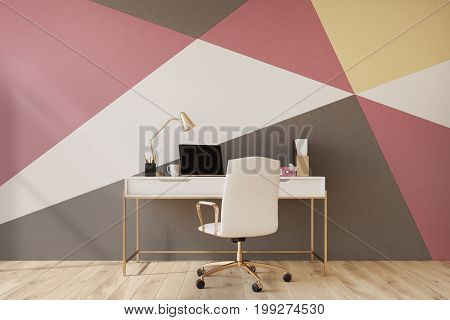 Black red yellow and white geometric wall pattern home office with a wooden floor a square poster a laptop and a white chair near a computer table. 3d rendering mock up