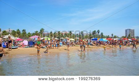 SALOU, SPAIN - AUGUST 3, 2017: Vacationers at the Llevant Beach in Salou, Spain. Salou is a major destination for sun and beach for European tourism with more than 50,000 accommodations