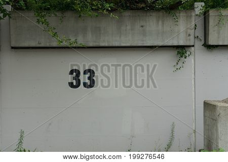 33 number on wall parking space painting
