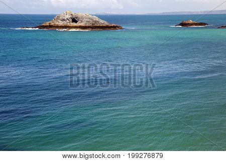 Beautiful Cornish seascape with small islands in shot.
