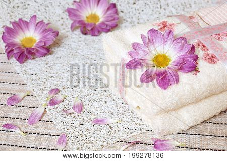 Hotel towel. Two towels and flowers of chrysanthemums.