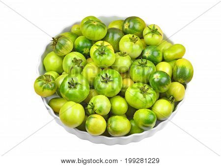 Green tomato in plate isolated on white background