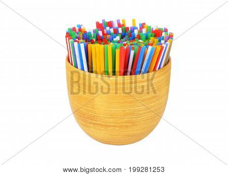 Colorful drinking straws in ceramic flower pot