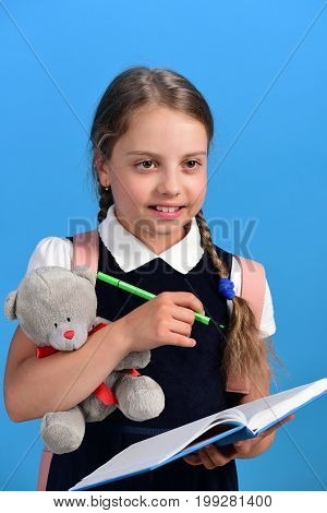 School Girl With Smiling Face Isolated On Blue Background