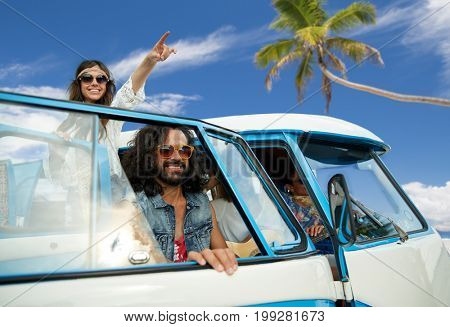 summer holidays, road trip, travel and people concept - smiling young hippie friends in minivan car over tropical beach background