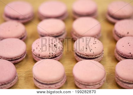 cooking, confectionery and baking concept - macarons on table