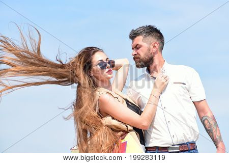 Couple Holds Packets On Blue Background. Sexy Girl And Guy