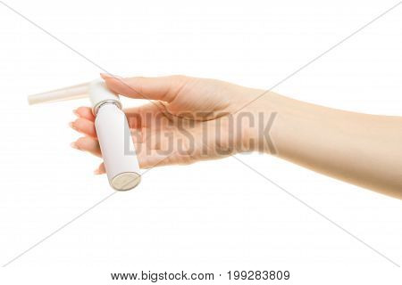 Spray for throat in female hand  on white background Isolation