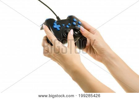 Gamepad in a female hands on a white background isolation