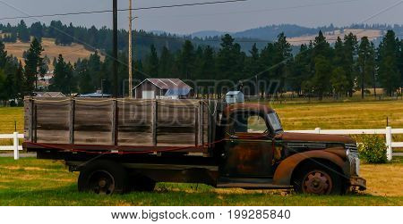 Vintage post war farm truck used for hauling hay and other farm related goods