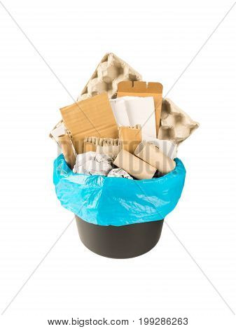 Separate garbage collection. Paper waste in the black bucket and blue plastic bag isolated on white.