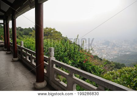 Terrace viewpoint on the mountain top urban background