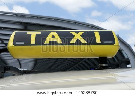 Taxi sign against blue sky in Summer