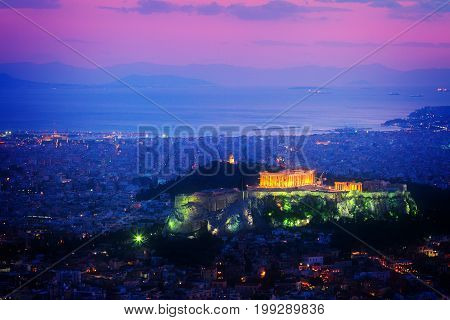 cityscape of Athens with illuminated Acropolis hill and Pathenon temple at night, Greece, retro toned