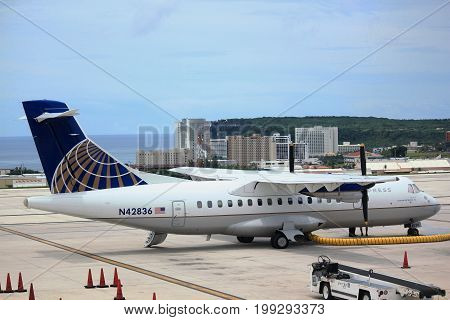 GUAM, USA--A United Airlines aircraft waits for passengers to Saipan from Guam International Airport in December 2016.