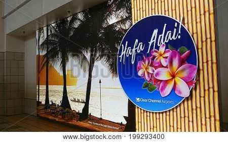 GUAM, USA--A Welcome to Guam sign and an enlarged backdrop photo at the arrival area of the Guam International Airport.