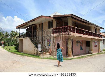 GUAM, USA--A visitor walks toward the George Flores Memorial Old Store and History center in Inarajan Village, Guam in December 2016.