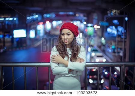 Portrait of lonely asian woman outdoor in night. Christmas and New Year concept
