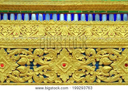 Close up pattern of Lai Thai on the base of windows Thai Buddhist church in Chiang Mai Thailand.