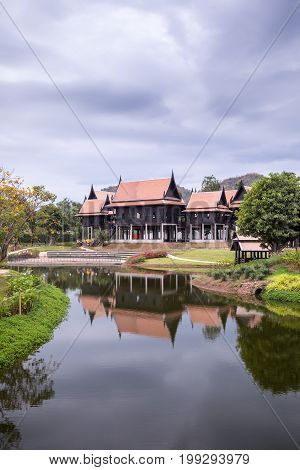 Thai traditional houses style near river in Thailand