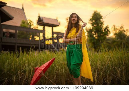 Thai woman dressing with umbrella traditional style