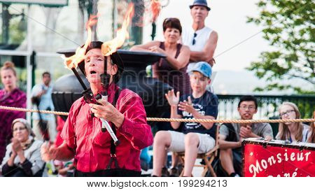 Quebec City - July 05 2017: Monsieur Rene entertains tourists at Terrasse Dufferin. Different artists do presentations at the same place during the summer in Quebec City.