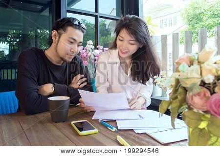 young asian freelance working at home happiness and smiling face