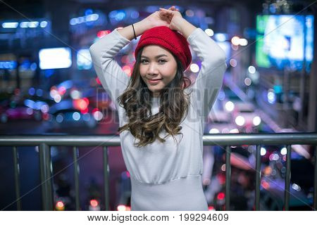 Portrait of asian woman outdoor in night.