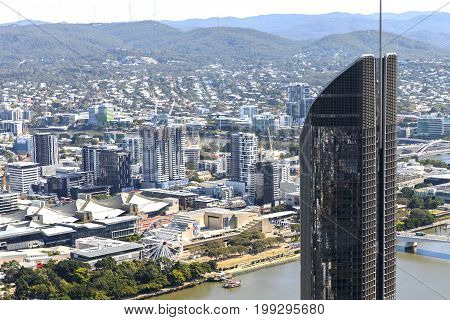 BRISBANE, AUSTRALIA - AUGUST 1 2017:   Aerial view close up of Brisbane's 1 William Street building with Southbank and Brisbane Wheel below in the background.
