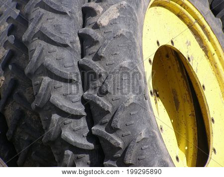 tractor tires leaning against each other with heavy tread