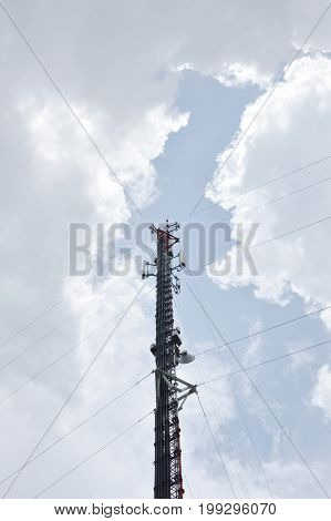 telecommunication pole on cloud and sky in sunlight